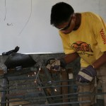 Photo1_Hulas participant with his welding project