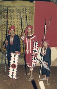 A family prepares to dance the Saut, a war dance