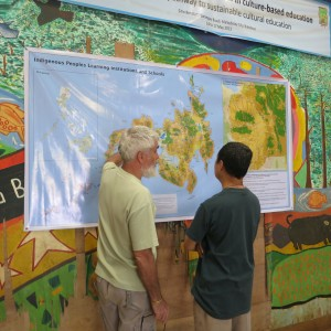 Pedro Walpole, SJ and Father Provincial Tony Moreno, SJ looking at a Mindanao map showing ecology and indigenous cultures and education