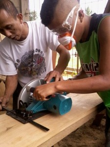 Teaching a youth participant how to use the circular saw