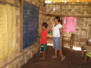 Kinder teacher, Ate Cecil, teaches spelling  in Pulangiyen
