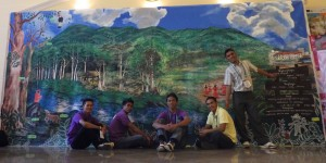 From left to right: Israel Menaling, Ariel Hagilay, Brian Guinton, Arnel Santander and Jason Menaling APC mural painting which portrays the balanced relationship of Migtanghaga (creator), tanghanga (creation) and the Pulangiyen community.